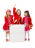 Girls in red are holding white billboard Stock Images