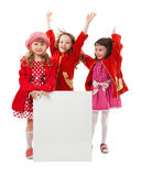 Girls in red are holding white billboard Stock Photo