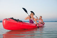 Girls with red kayak Royalty Free Stock Photography