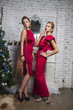 Girls in red party dress near new year tree Royalty Free Stock Photography