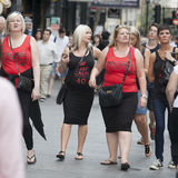 Girls in red T-shirts walk on the street at the hens party Stock Photo