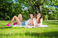 Girls relaxing in bosom of nature Royalty Free Stock Image