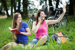 Girls relaxing on a glade Stock Image