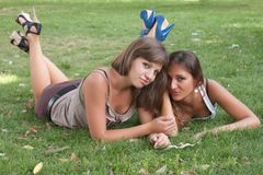 Girls relaxing on the lawn Stock Images