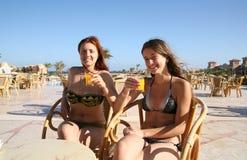 Girls relaxing with orange juice Stock Photo