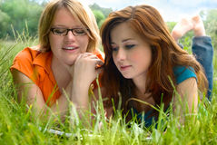 Girls relaxing outdoor stock photography