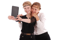 Girls remove self tablet pc Royalty Free Stock Images