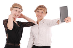 Girls remove self tablet pc Stock Photography