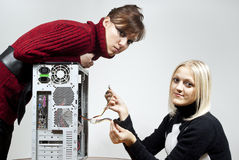 Girls repair the system unit Stock Photo
