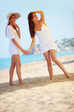 Girls resting at beach Stock Images