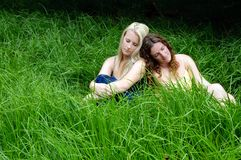 Girls resting in the field Stock Photos