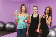 Girls resting after fitness training conducted. Royalty Free Stock Photo