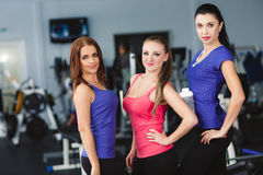 Girls resting after fitness training conducted. Royalty Free Stock Image