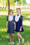 The girls are resting in the schoolyard. Schoolgirls in vintage school uniform Royalty Free Stock Image