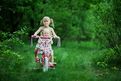 Girls ride bicycle Stock Photography