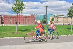 Girls ride bikes. Crimean embankment. Moscow Stock Image