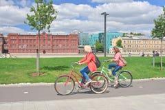 Girls ride bikes.  Moscow Stock Photo