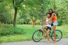 Girls riding Stock Image