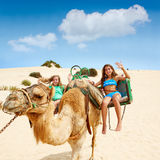 Girls riding Camel in Canary Islands Royalty Free Stock Photos