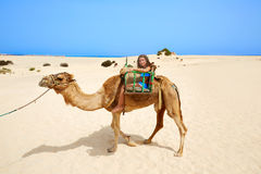 Girls riding Camel in Canary Islands Stock Images