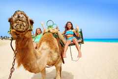 Girls riding Camel in Canary Islands Royalty Free Stock Images