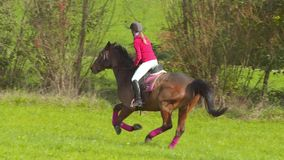 2 Girls Riding Meadow Slow Motion stock video footage