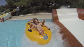Girls riding at the water park stock footage