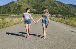 Girls are on the road for hands Stock Images