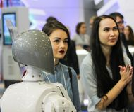 Girls and the robot. Royalty Free Stock Image