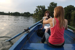 Girls Rowing A Boat Stock Photo