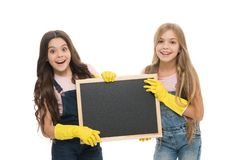 Girls with rubber protective gloves ready for cleaning. Household duties. Little helper. Girls cute kids cleaning. According to duty, blackboard copy space stock image