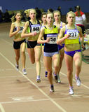 Girls run 800 meters race Stock Photos