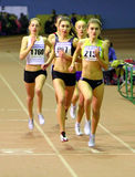 Girls run 800 meters race Stock Photo