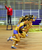 Girls run on the finish. Unidentified girls of the 60 meters dash on the Ukrainian Cup in Athletics on January 27, 2012 in Zaporizhia, Ukraine Stock Image