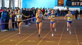 Girls run on the finish stock photography