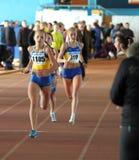 Girls run relay race Stock Photography