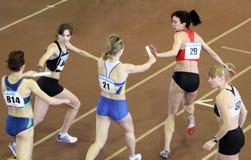 Girls run relay race Stock Photo
