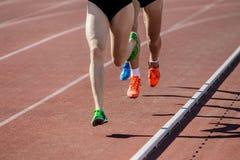 Girls runners run on track stadium Royalty Free Stock Photos