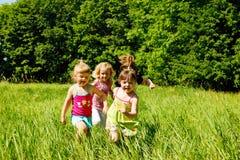 Girls running Royalty Free Stock Image