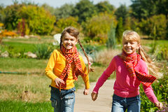 Girls running. Two girls running in the garden Royalty Free Stock Photos