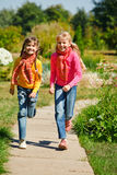 Girls running Royalty Free Stock Images