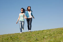 Girls running along field Stock Images