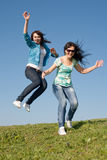 Girls running along field Royalty Free Stock Photos