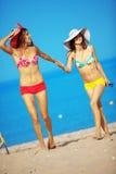 Girls running at beach Stock Photo