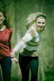 Girls running in the forest Stock Photography