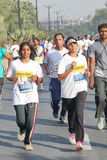 Girls running at Hyderabad 10K Run Event, India Stock Image