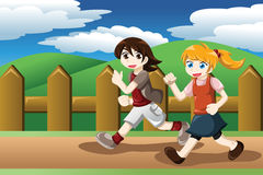 Girls running outdoor Royalty Free Stock Image
