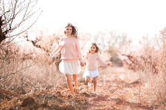 Girls running outdoors Royalty Free Stock Photography