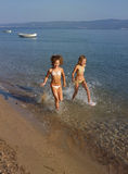 Girls running on sea Stock Images