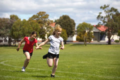 Girls running in sports race Royalty Free Stock Images